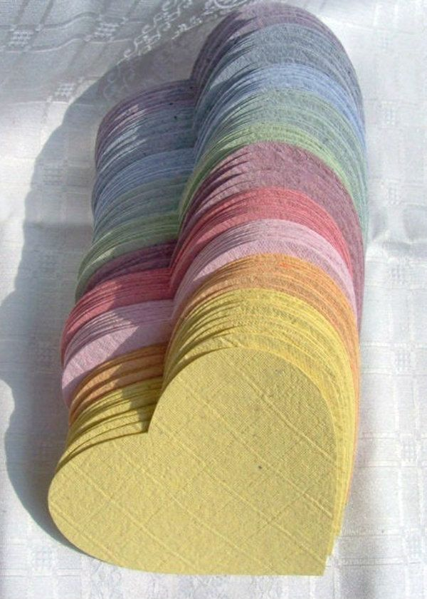stack of handmade paper hearts in assorted colors