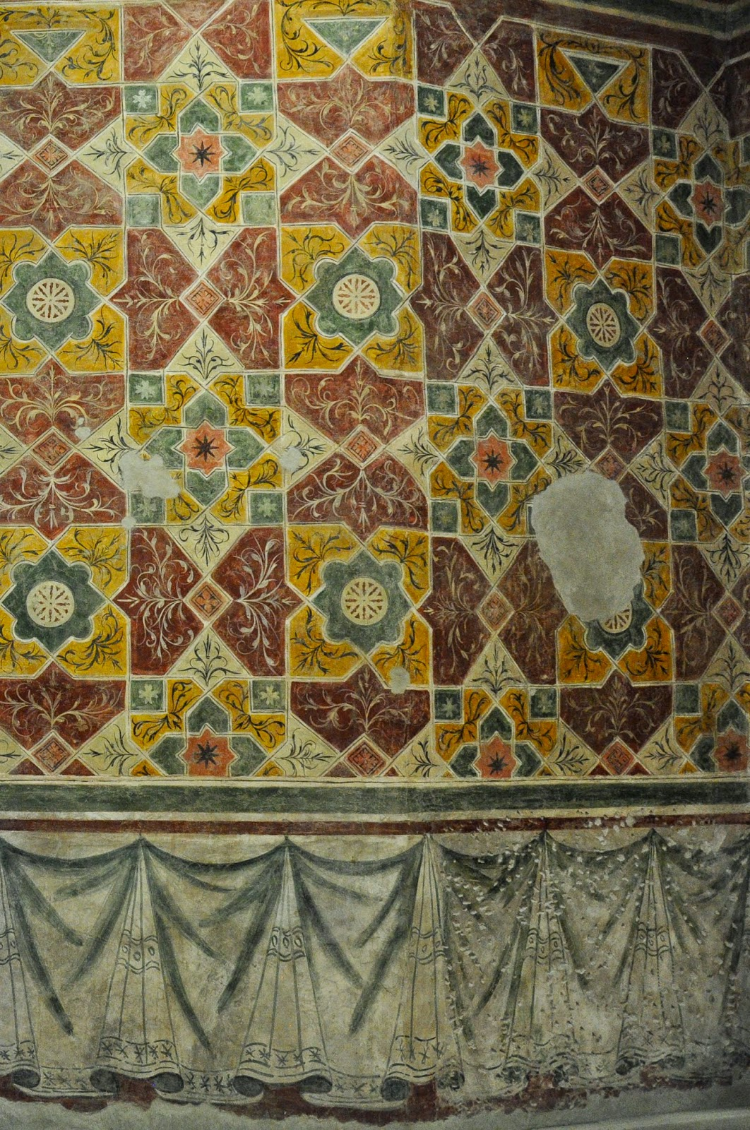Preserved painted wall of a room in the Museum of Castelvecchio in Verona