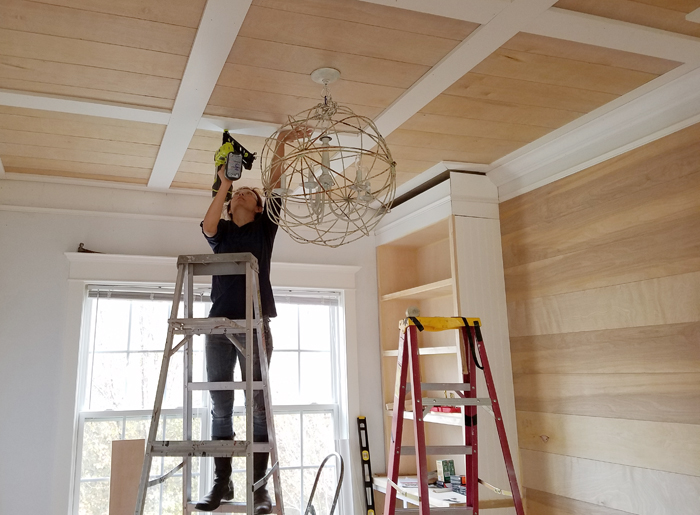 diy ceiling projects - Cristina Garay installing ceiling treatment in dining room