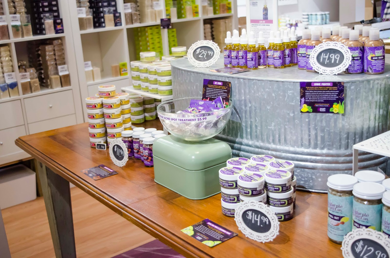 A table in Purple Urchin's store with hand creams, face creams and other handmade skincare products