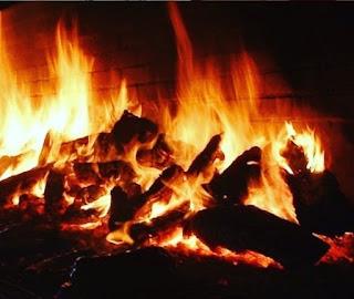 El asado de tira, el fuego y las brasas.
