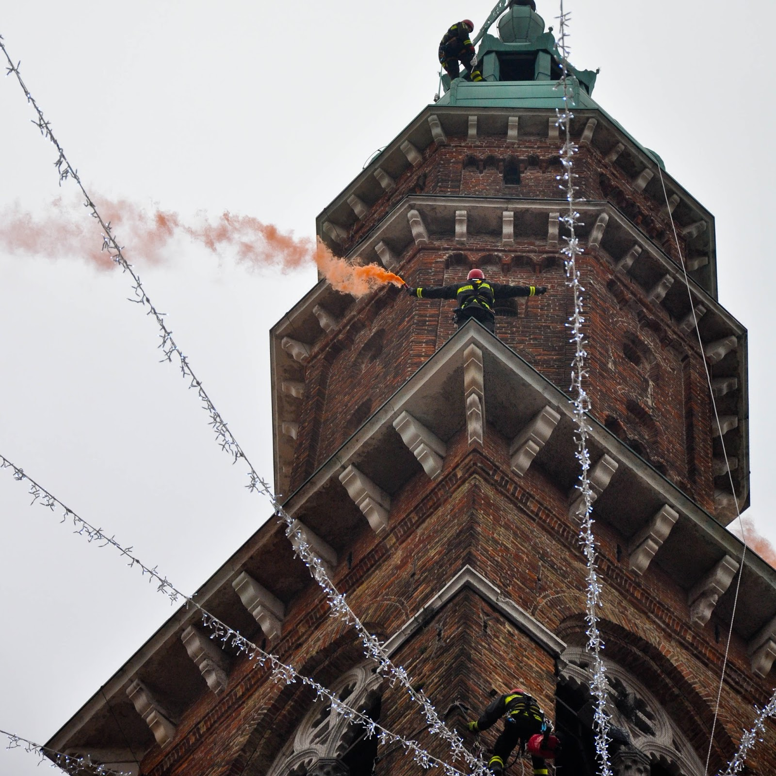 Firefighters demonstrating on top of the clock tower of Palladio's Basilica, Saint Barbara celebration, Vicenza, Veneto, Italy