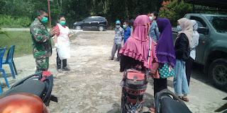 TNI Bersama Satgas COVID-19 Kawal Warga Jalani SWAB CR