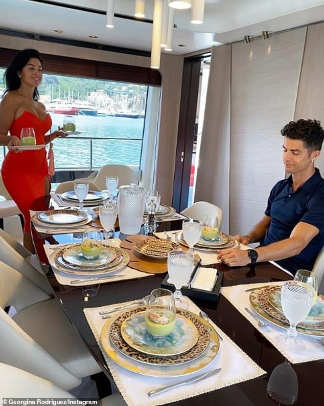 Ronaldo & Rodriguez tucks in to a extravagant lunch in the dining room on Yacht