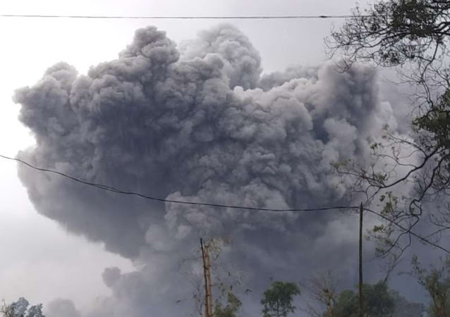 Mount Semeru volcano spews hot ash and smoke into the sky on the island of Java in Indonesia