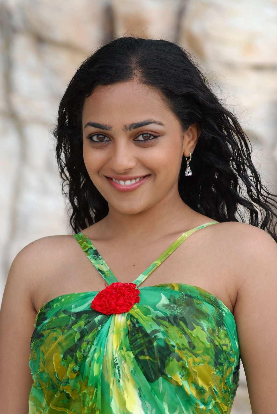 Actress Nithya Menen Beautiful Smiling Face Close Up Photos