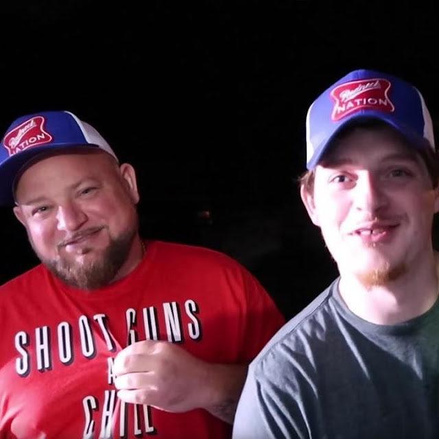 'SHOOT GUNS AND CHILL' T-shirt worn by hick hop country rapper Bottleneck posing with Upchurch.