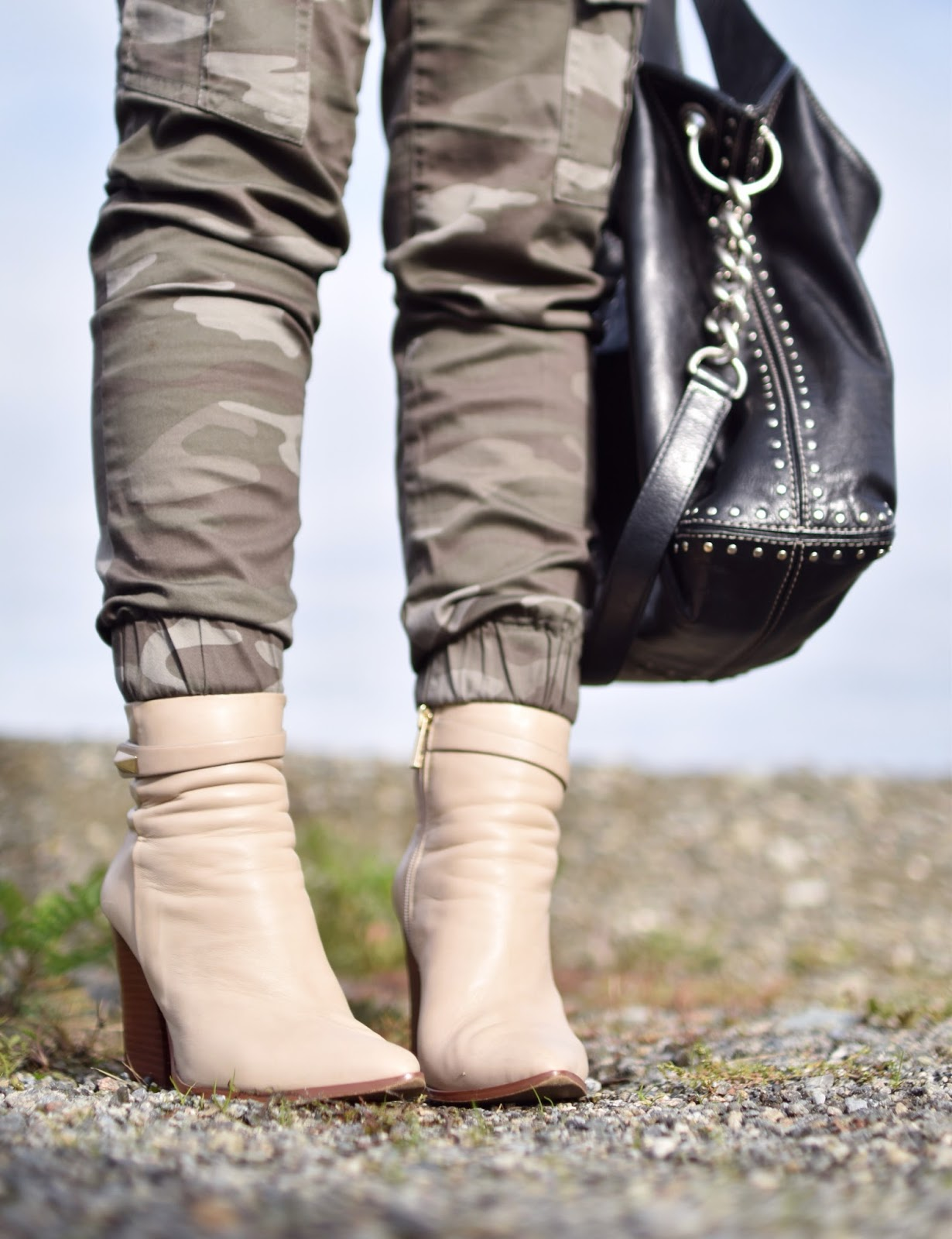 Monika Faulkner outfit inspiration - camouflage trousers, Vince Camuto ivory booties, MK black studded bag