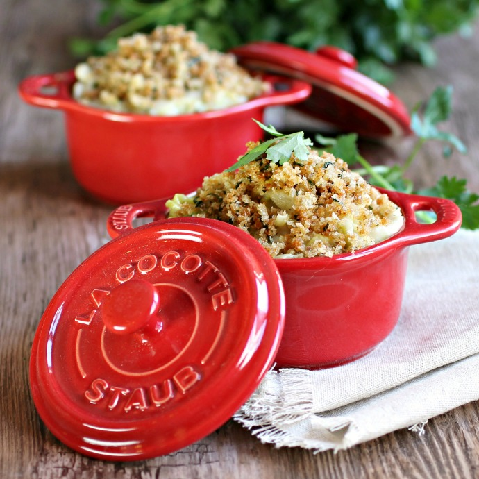 Recipe for a side dish of cabbage simmered in a cheesy sauce with a breadcrumb topping.
