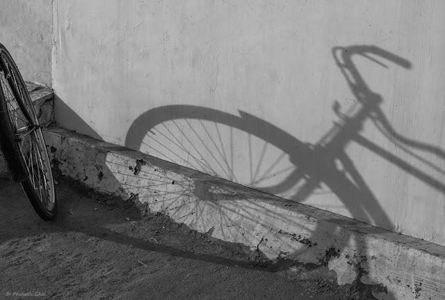 Long Shadow of a Bicycle being Cast on a White Wall. Shot at Jaipur, Rajasthan.