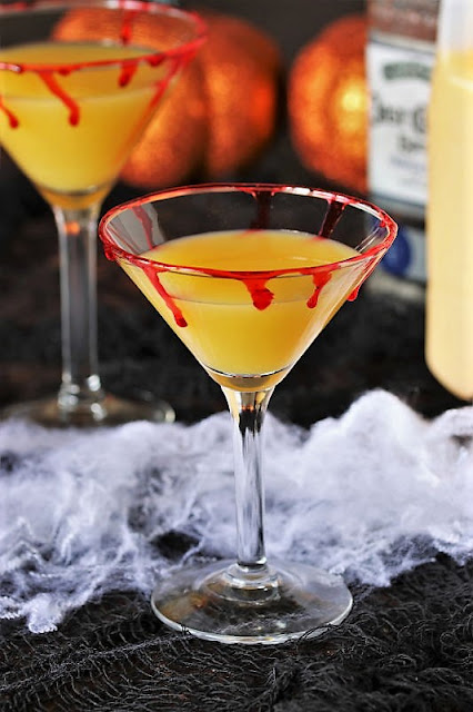 Orange Juice in Martini Glass to Make Bloody Sunrise Halloween Cocktail Image