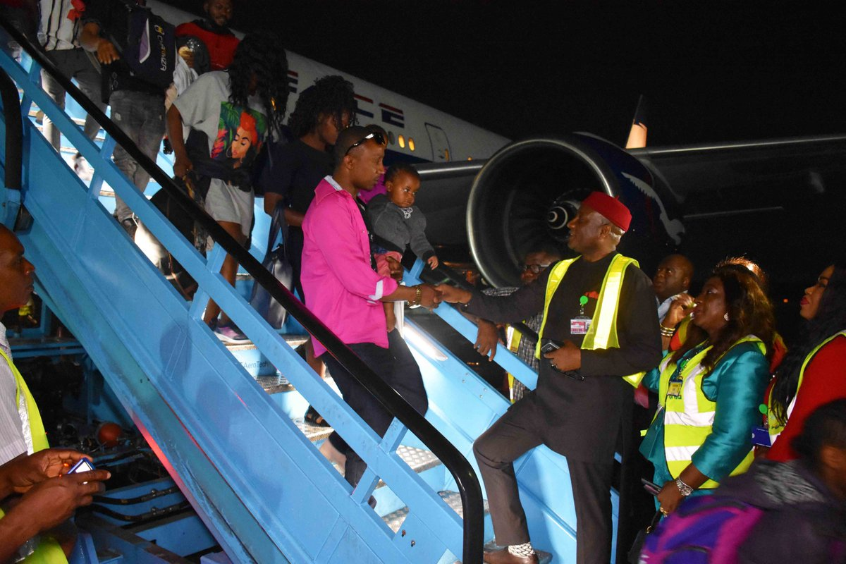Emotional Moments As South-Africa Returnees Arrive Lagos - Photos