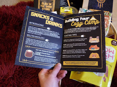 A close up of the date night guide, the page is open on the snacks and drinks page. It is blue with white and yellow writing