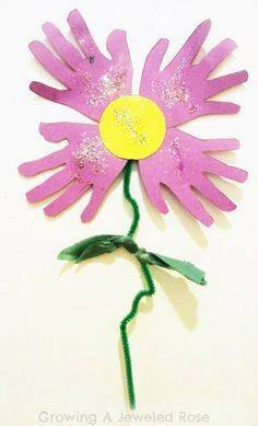 Idea to make flowers from paper handprint for kids 4