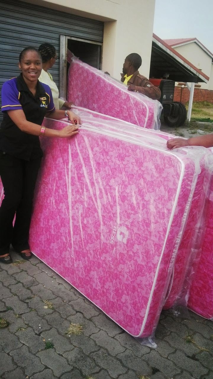 The Hollywoodbets team with new mattresses being donated to the SOS Children's Village