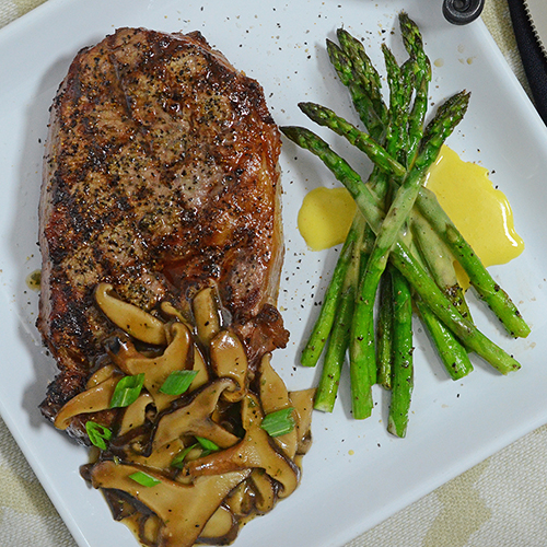 Grilled Certified Angus Beef Prime Ribeye Steak with Fire Roasted Asparagus