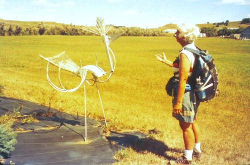 hiker talking to a metal bird