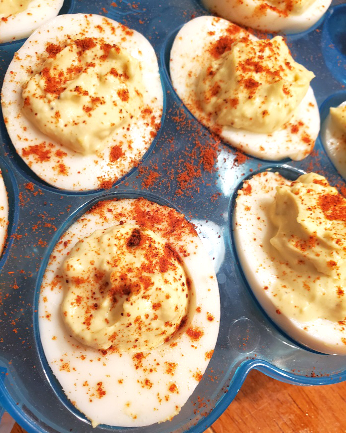 these are hard boiled eggs made into deviled eggs sprinkled with paprika