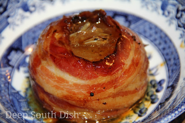 Sweet Vidalia onions, stuffed with garlic and butter and drizzled with balsamic vinegar, wrapped in bacon and placed in individual packets to be cooked on the grill or oven.