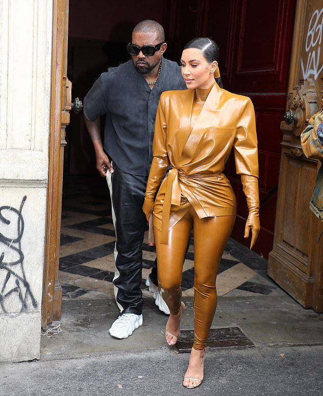 Kim donned a high necked polo and skin tight pants under the latex blazer