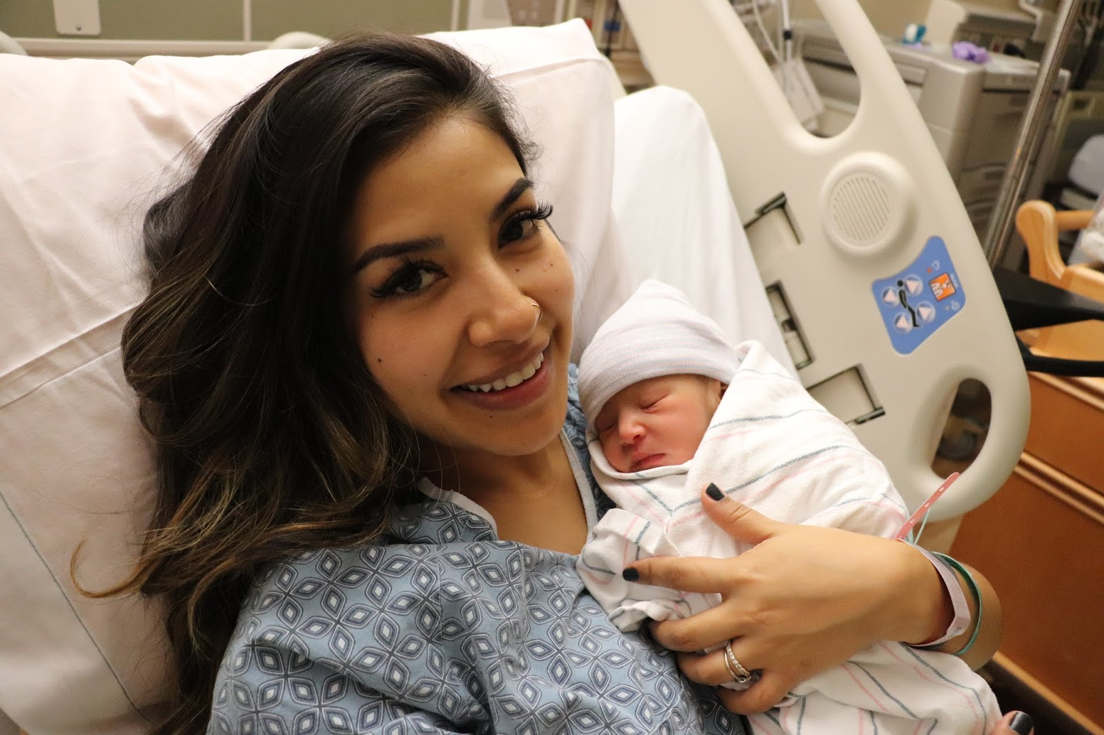 new_mom_with_newborn_baby_after_giving_birth