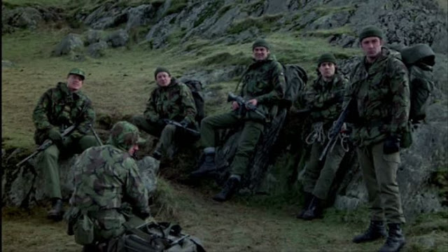 Camouflaged soldiers on a mountain side
