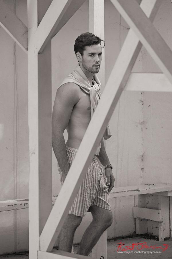 Shirt off casual shot in change room at beach. Male modelling portfolio by Kent Johnson, Sydney, Australia.