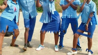 Burundi students in a ripped-off uniform after finishing high school. PHOTO | BBC