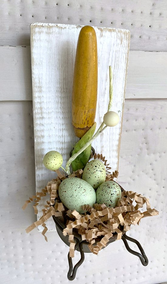 Speckled egg spring decor using an old strainer