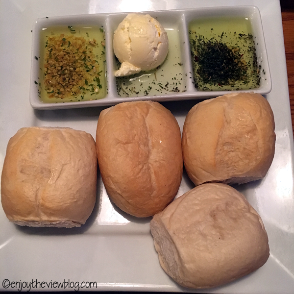dinner rolls, butter, and dipping oils