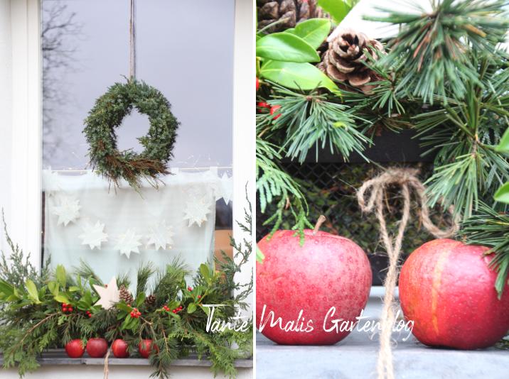 Mit Naturmaterialien dekorierte Fensterbank weihnachtlich