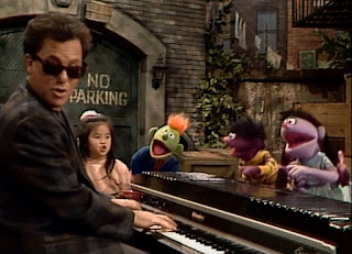 Billy Joel sings The ABC Alphabet Song with a lot of kids and some of the Anything Muppets.