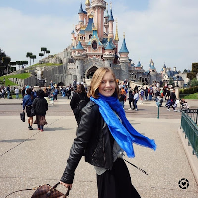 awayfromtheblue Instagram | Disneyland paris maxi skirt leather jacket cobalt louis vuitton shawl and bag castle