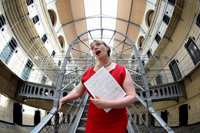 Elizabeth Hilliard at Kilmainham Gaol Museum with the score of Gráinne Mulvey's Great Women, for Dublin International Chamber Music Festival