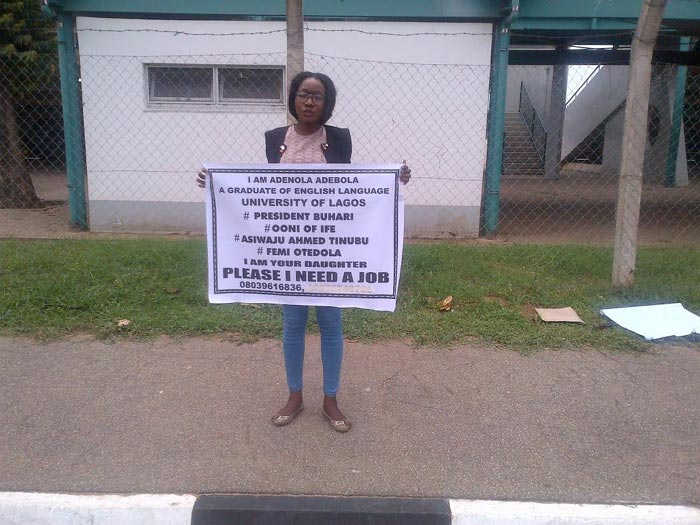 Unemployed youths carry posters demanding for jobs
