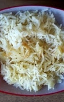 Manzo (boeuf) Bourguignon con cipolline, champignon e riso pilaf