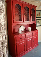 Red painted dining room hutch with white decoration