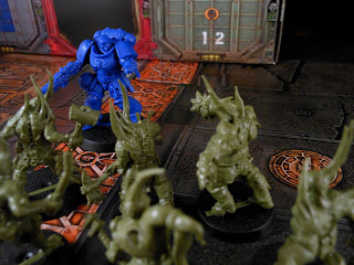 An Intercessor Sergeant charges a unit of Poxwalkers in Warhammer 40,000: First Strike.