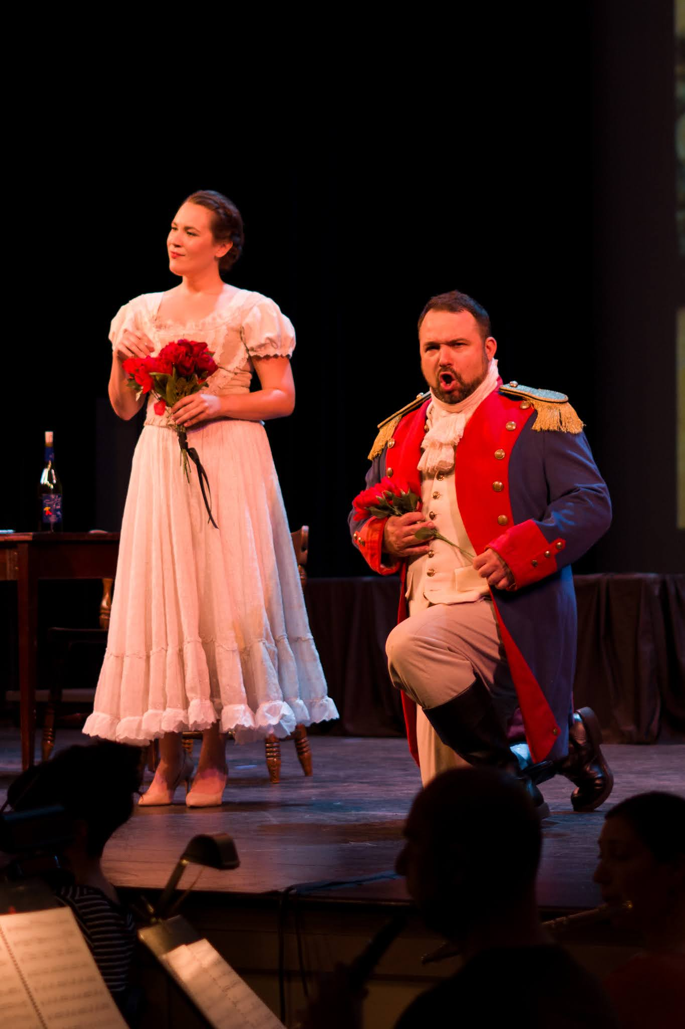 IN REVIEW: soprano CHRISTINE TAYLOR PRICE as Adina (left) and bass-baritone LEO RADOSAVLJEVIC as Belcore (right) in the Emerald Cast of Opera in Williamsburg's September 2021 production of Gaetano Donizetti's L'ELISIR D'AMORE [Photograph © by Diego Valdez; used with permission]