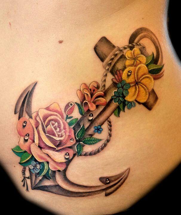 tatuaje de ancla y flores
