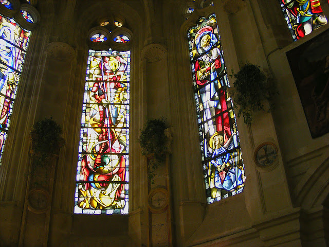 Stained glass windows in the chapel of the Chateau of Chenonceau. Indre et Loire. France. Photo by Loire Valley Time Travel.