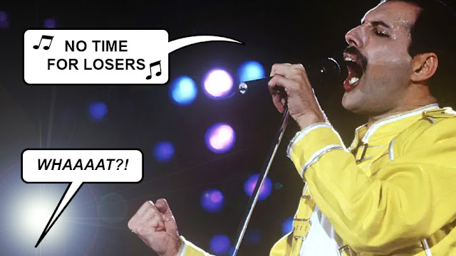"""Freddie Mercury singing """"no time for losers"""" from We Are The Champions, and someone off camera shouting """"WHAT?!"""""""