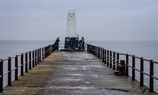 Photo of fishermen on Maryport pier in misty conditions