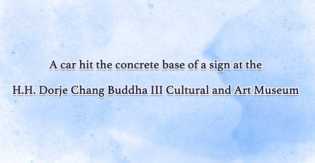 A car hit the concrete base of a sign at the H.H. Dorje Chang Buddha III Cultural and Art Museum