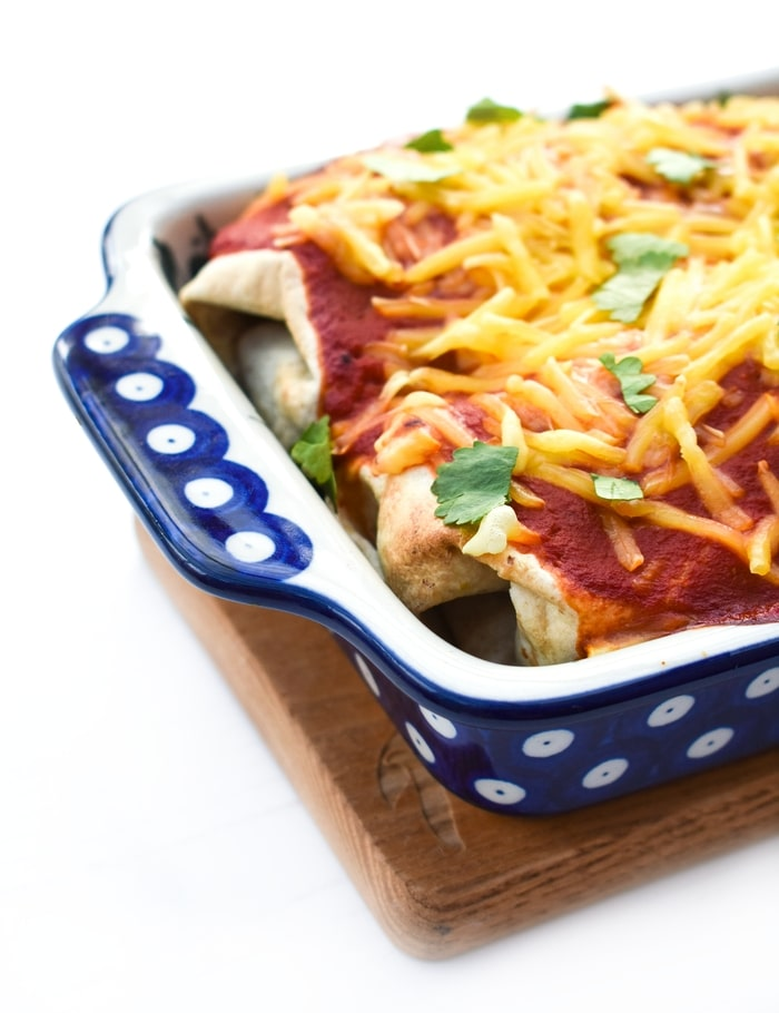 Tex Mex Enchiladas in a blue and white patterned casserole dish