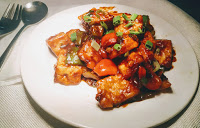 Garnished Chilli paneer serving