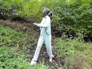 Sculpture of lady in tracksuit