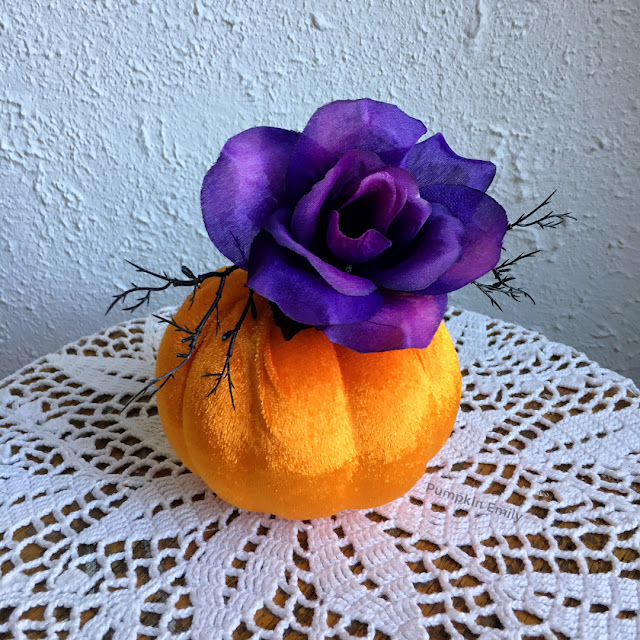 felt flower pumpkin with a flower on it