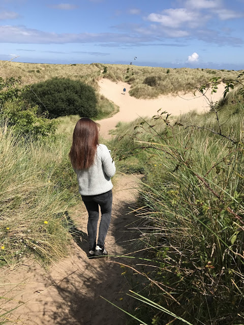 Exploring Bamburgh beach sand dunes