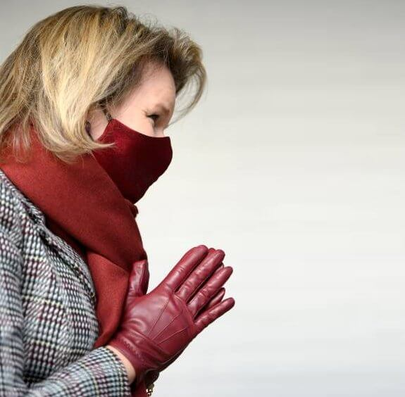 The Queen Elisabeth Music Chapel. Queen Mathilde wore a checked print long coat from Natan, and burgundy mask from Natan, Armani silk blouse